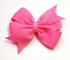 Dubbele strikken roze grosgrain